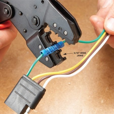 <b>Photo 1: Crimp the connector</b></br> Strip the insulation so only the bare wire is inside the connector. Then make a single 5/16-in. crimp on each side of the butt connector.