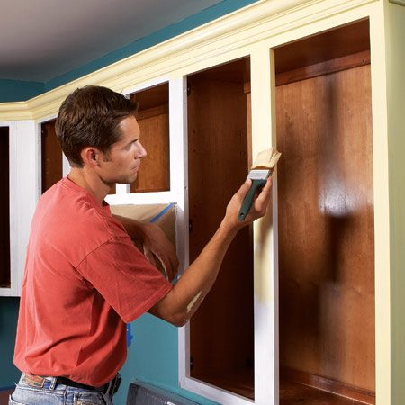 <b>Photo 6: Use a brush for frames</b></br> Start in a corner to paint the cabinet frames. Use a high-quality paintbrush to paint an entire rail or stile, including the inside edge, before moving to an adjacent rail or stile.