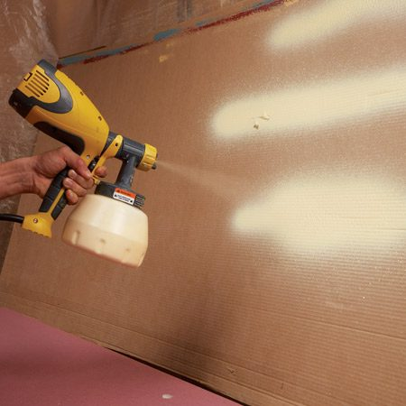 <b>Photo 7: Practice first</b></br> Practice spray painting on cardboard. Adjust the nozzle to get a vertical fan pattern. Adjust the flow rate so the paint covers the surface without running.