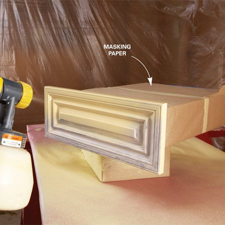 <b>Photo 10: Paint drawers</b></br> Paint the drawers with the sprayer after wrapping the inside with plastic or paper. Paint the backs first, then the edges and then the faces, starting at the top and working down. Start and stop the spray past the sides of the drawer.