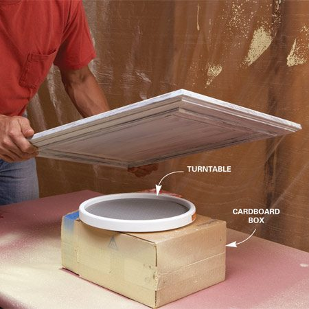 <b>Photo 8: Rotate the doors while painting</b></br> Set the doors on a turntable when spray painting. Then you can stand in one spot and rotate the door to paint each side. Keep the nozzle 10 to 12 in. from the door and maintain a consistent angle while spraying.