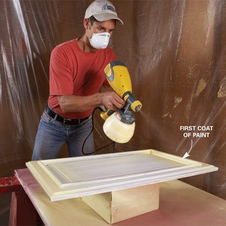 <b>Photo 9: Paint edges</b></br> Paint the edge and detail work on one side, then turn the door to paint the adjacent edges and details. Start the spray before the door, and keep spraying past the edge. Don't worry if you missed a spot. You can catch it on the second coat.