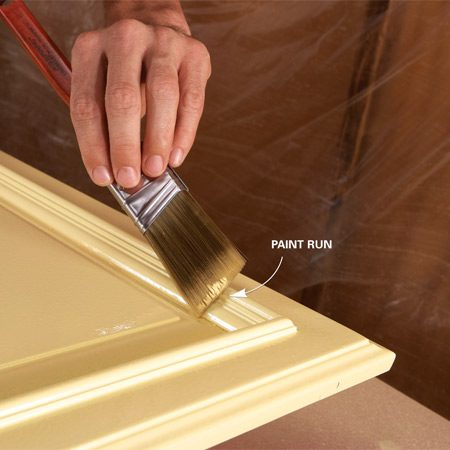 <b>Photo 11: Touch up runs</b></br> Fix paint runs with a paintbrush while the paint is still wet. If the paint is dry or tacky, wait until the next day, then sand out the run or imperfection and repaint.