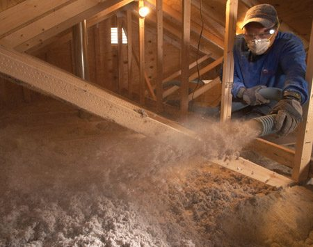 """<b>Photo 6: Fill to your marks </b></br> <p>Start at the   farthest point   from the hatch and   sit in the center of   the attic. """"Don't   move around a lot in   the attic with the   hose,"""" says Olson.   """"Work from the middle   and do three   bays at a time.""""   Push the hose out   to the eaves and   blow those areas   first. Then pull the   hose back and use a   slow, steady sweeping   motion until you   reach the desired   level. Then pivot in   place and blow the   opposite side of the   attic the same way. </p>"""