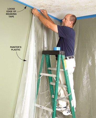<b>Photo 1: Mask the ceiling</b></br> Speed up and simplify your masking job by applying the tape along the ceiling first. Leave the lower edge of the tape loose. Then roll out a length of lightweight poly along the floor, pull one edge up to the ceiling, and stick it to the tape.