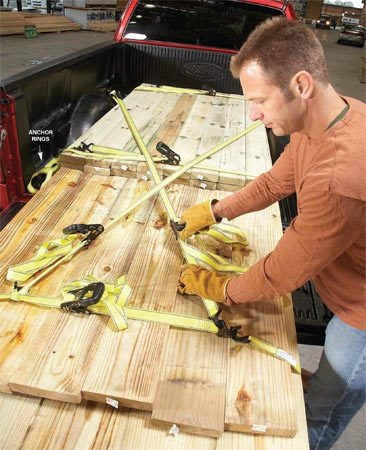 <b>Stop wood from bouncing out</b></br> <p>If you're hauling a large load of long lumber, don't rest it on a raised gate—it just can't handle that kind of weight. Start by laying out two or more ratchet straps along the bottom of the bed and load the longest and heaviest lumber over the straps. Then stack shorter lengths on top. Secure the cab end, the middle and the trailing end with the straps.</p>  <p>Next, anchor the bundle to the truck bed with two ratchet straps. Crisscross the ratchet straps across the load, attaching one end to the cab end anchor rings and the other end to the farthest bundle strap.</p>