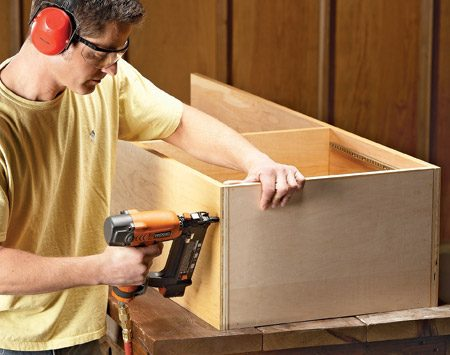 <b>Photo 4: Nail first, then screw</b></br> If you have a brad nailer, tack the boxes together to hold the parts in position. Then add screws for strength.