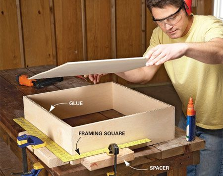 <b>Photo 5: Square the drawer boxes</b></br> If the boxes aren't square, the drawers won't fit right or glide smoothly. Drawers take a beating, so assemble them with nails and glue.