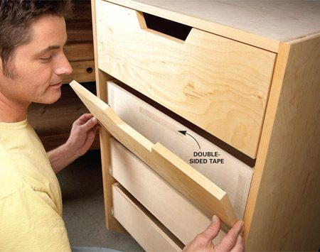 <b>Photo 6: Center the drawer faces perfectly</b></br> Stick the faces to the boxes with double-sided tape. Then pull out the drawer and drive screws from inside the box.