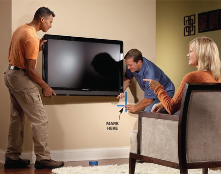 <b>Lower or higher?</b></br> It takes three people to position a TV. When you've found the right spot, mark one corner with masking tape. Set the TV aside and add tape to mark the bottom edge and the other corner.