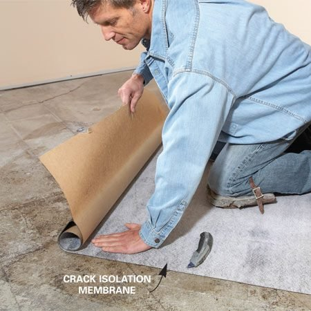 <b>Photo 3: Isolate cracks</b><br/>Apply a layer of crack isolation membrane over cracks to prevent cracks from appearing later in the overlying tile.