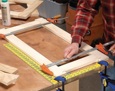 <b>Photo 1: Build four frames</b></br> Glue together the frames that form the sides of the planter box. Clamp a framing square to your workbench to help align the parts.
