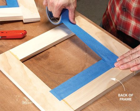 <b>Photo 2: Mask the frames</b></br> Line the backs of the frames with wide masking tape. When you finish the wood later, the tape will keep stain off the bamboo.