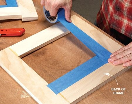 <b>Photo 2: Mask the frames</b><br/>Line the backs of the frames with wide masking tape. When you finish the wood later, the tape will keep stain off the bamboo.