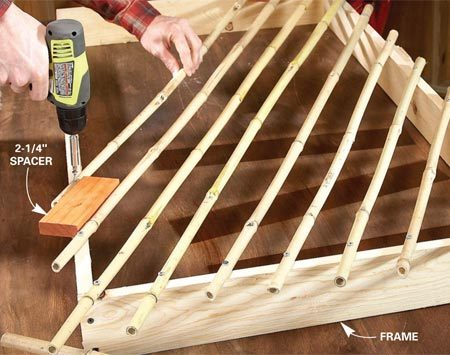 <b>Photo 5: Build the lattice on a frame</b></br> Screw the first layer of bamboo poles directly to the frame, using spacer blocks to position them. Drill a pilot hole for every screw; bamboo splits easily.