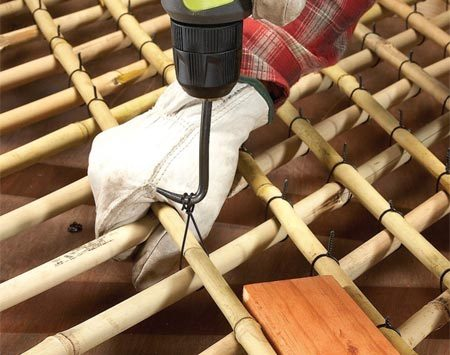 <b>Photo 6: Wire the lattice together</b></br> Tie the second layer of bamboo to the first with wire ties. Twist until the looped ends snap off. Then bend the remaining wire flat against the bamboo.