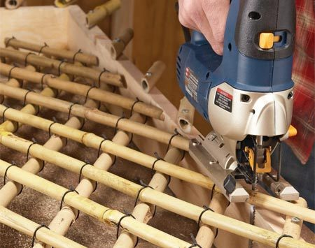 <b>Photo 7: Cut out the lattice</b></br> Trim the completed lattice off the frame by guiding a jigsaw or reciprocating saw along the inner edge of the frame.