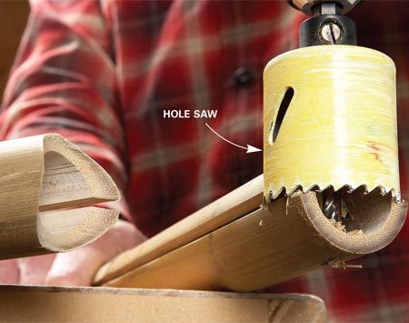 """<b>Photo 9: Cut """"saddles"""" with a hole saw</b></br> Create rounded ends on the trellis posts to hold the header. For a clean cut, run the drill at high speed and apply light pressure."""