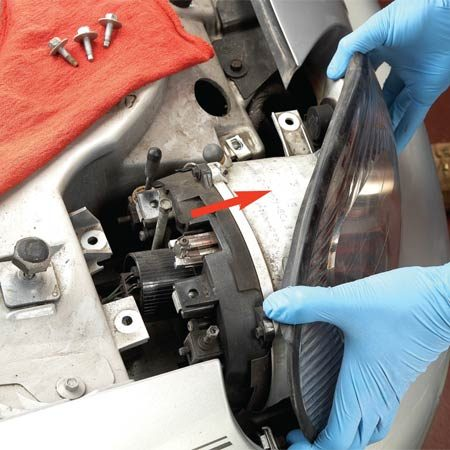 <b>Photo 1: Unbolt the headlight </b></br> Eliminate the hassle of trying to fish the bulb out from under the hood. Remove the headlight assembly retaining bolts and pull the whole unit forward.