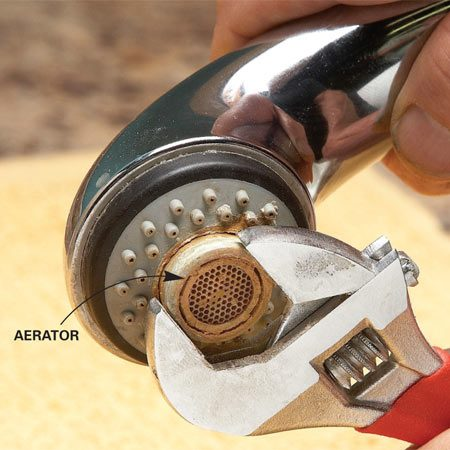 <b>Photo 4: Check the aerator</b><br/><p>Unscrew the  aerator with a pliers or wrench. Some pullout spray heads don&rsquo;t have removable<br />   aerators. Call  the manufacturer if you can&rsquo;t tell. </p>