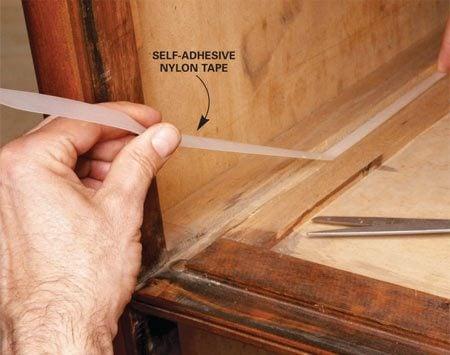 <b>Apply nylon tape</b></br> Self-adhesive nylon tape lubricates rubbing surfaces.