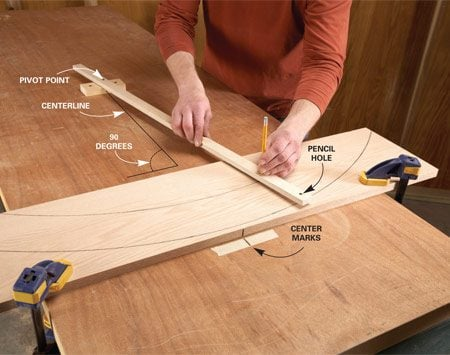<b>Drill two pencil holes for parallel curves</b></br> Clamp the board and screw the compass to the workbench. Use a scrap to elevate the compass to the same height as the board you're marking. Make sure the pivot point of the compass is at 90 degrees to the center of the board.