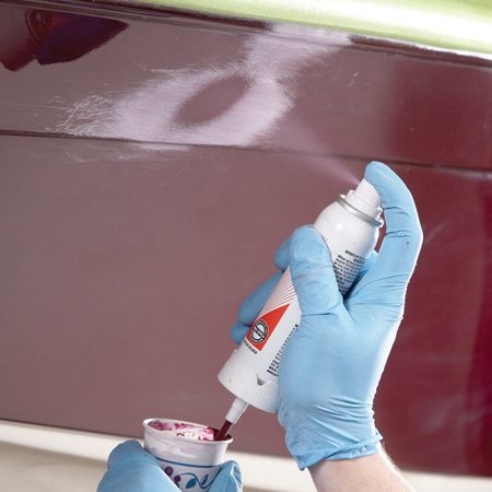 <b>Photo 7: Spray on the final coat</b></br> Pulse the sprayer to get short bursts of gel coat. Feather the spray along the edges to reduce sanding.