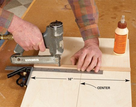 <b>Photo 1: Attach the runner</b></br> Cut 3/4-in. plywood to 16 x 24 in. Draw centerlines on both sides, then glue and pin the runner to the bottom. Send the jig through the blade until you reach the centerline, then clamp the auxiliary fence to the jigsaw fence.