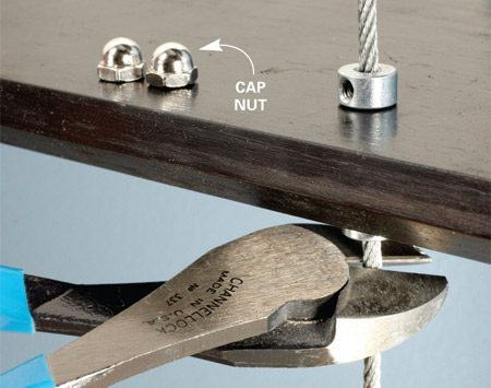 <b>Photo 9: Trim and cap the cable</b></br> Use a side-cutting pliers or lineman's pliers to cut the cable. Leave 1/4 in. protruding. Cover the end of the cable with a cap nut. Use hot-melt glue or silicone caulk to hold the cap nut in place.