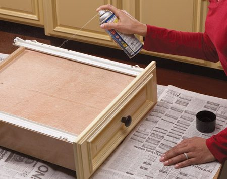 """<b>Make drawers slide again</b></br> <p>The fix for sticking drawers is easy. First remove the drawer. Wipe the drawer slides and the cabinet track with a clean cloth to remove any debris. Then spray a dry lubricant directly on the drawer slides. Cans are sold at home centers; it'll say """"dry lubricant"""" on the label. Replace the drawer and slide it in and out of the cabinet several times until it glides easily. If the drawer is still hard to open, replace the drawer slides.</p>  <p>Dry lubricants won't leave an oily residue that attracts dirt and dust. The lubricants also work great on squeaky hinges.</p>"""