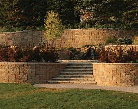 <b>Large retaining walls</b></br> Heavy-duty walls require full-size blocks, which are available at landscape suppliers.