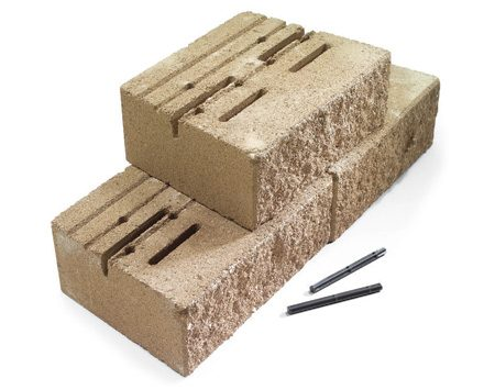 <b>A pin or a clip system</b></br> A pin or a clip system, made from tough plastic or fiberglass, anchors each row of blocks to the ones below. These systems are fussier but will let you slide the block forward (no setback) if you need a more vertical wall (such as where a wall meets the corner of a house).