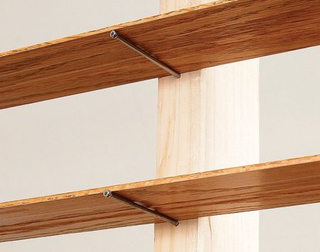 <b>Nails hold trim</b></br> Hammer 16d finish nails into the 2 x 4s just deep enough so they'll hold the trim without bending.