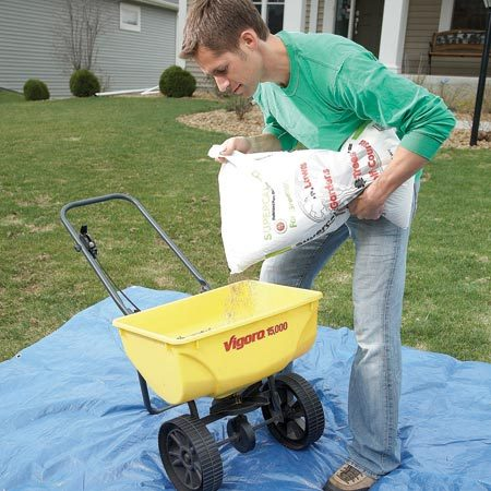 <b>Photo 3: Don't spill on the grass</b></br> Park your spreader over a tarp or your driveway when filling the hopper. Spills and leaks can saturate one spot of your lawn and kill your grass.
