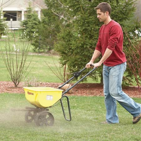 <b>Photo 4: Improve your soil</b></br> Soil activator helps retain water in sandy soils and loosens clay soils. It also helps aerate the soil, decompose grass clippings and reduce erosion.