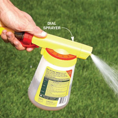 <b>Photo 10: Use your hose for large areas</b></br> Use a dial sprayer hooked up to your hose to kill large areas of weeds. Spray the herbicide on a calm day so the weed killer won't drift onto your plants and flowers.