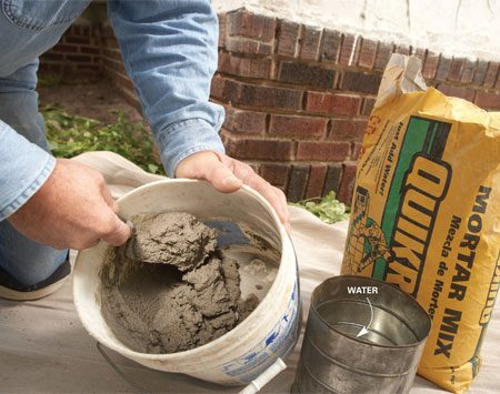 <b>Photo 6: Whip up the mortar batch</b></br> Mix the mortar to the consistency of peanut butter with no dry spots or clumps. You'll know the mix is right when it sticks to your trowel when you hold it at a 45-degree angle. Let the mortar sit for 10 minutes before using it.