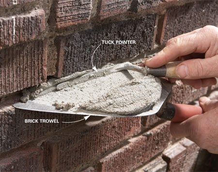 <b>Photo 7: Fill the joints</b></br> Load your brick trowel and hold it next to the joint. Work the mortar into the joint with your tuck pointer. Pack the joint full before moving on to the next one.