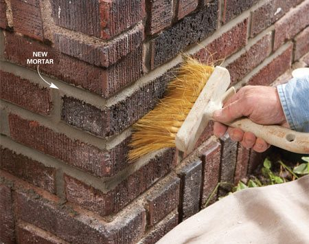 <b>Photo 9: Wipe down the bricks</b></br> Scrub the mortar off the bricks with a stiff brush. This also knocks down and smooths out any high spots along the joint edges.