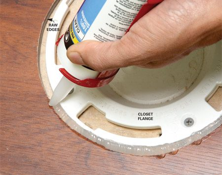 <b>Caulking</b></br> Hold off on setting the toilet and the baseboard molding until you've filled the expansion gaps around room perimeters and the toilet flange with 100 percent silicone caulk.