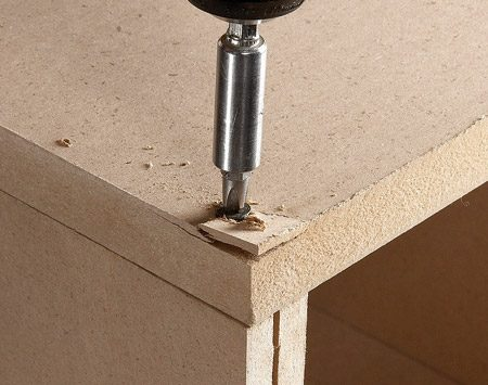 <b>Avoid splits and cracks</b></br> <p>MDF is kind of like an Oreo cookie: two   hard faces with a softer core between   them. That soft core splits easily when   you drive a screw into the edge. The   hard face presents different problems   for screws. If you don't drill a countersink   recess, the screw head may snap   off before it sinks into the MDF. Or, if   the head does sink, it might push up   chips. The cure for both problems is to   use a countersinking drill bit.</p>