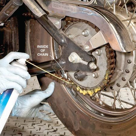 <b>Photo 2: Apply lubricant</b></br> Spray the sprocket side of the chain links, not the outside. Then take the bike for a spin. Centrifugal force will spin the lube deep into the links for complete lubrication.