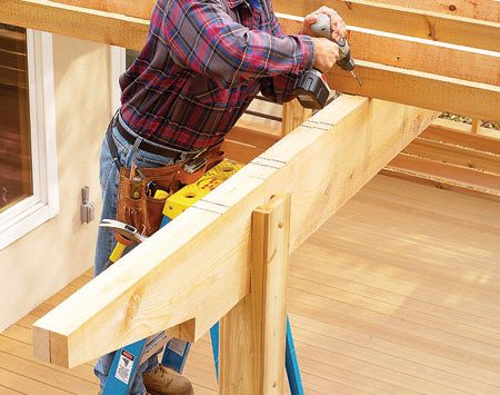 <b>Notch posts for extra support</b></br> Another method for providing strong support at the top and bottom of posts is to notch them to fit around the joists and the beams. Then drive construction screws through the notched posts to ensure a strong connection for maximum strength.