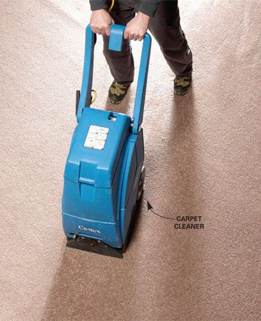 <b>Vacuum the water</b></br> Rent a commercial extractor or a carpet cleaner to suck out as much moisture as possible. Move slowly and do several passes in different directions.