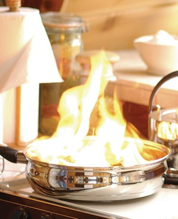 Keep a fire extinguisher and baking soda in the kitchen so you're prepared for home emergencies like grease fires.