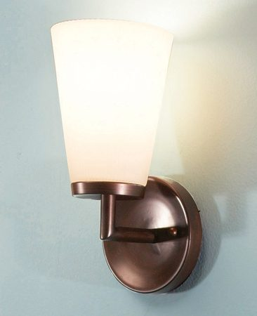 <b>Wall sconce</b></br> You can add a sconce above nearly any light switch in about three hours.