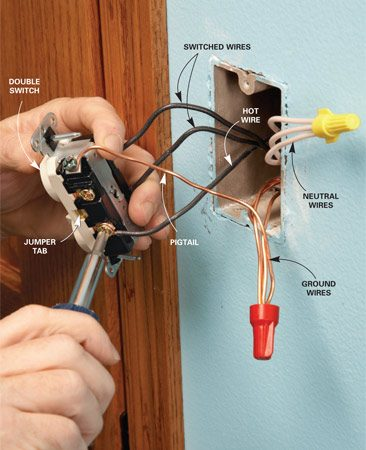 <b>Photo 7: Connect the switch</b></br> Strip the ends of the wires at the switch box. Connect the neutral white wires with a wire connector. Connect the ground wires with a 6-in.-long pigtail wire leading to the switch. Loop the black wires clockwise around the screws and tighten the screws.