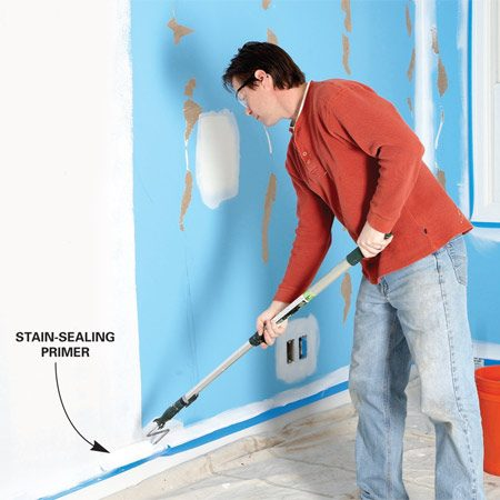 <b>Photo 1: Prime the walls</b></br> Roll a fast-drying, stain-sealing <a href='http://www.familyhandyman.com/painting/painting-how-to-choose-and-use-primers/view-all' title='drywall primer'>drywall primer</a> on the walls. The primer seals loose paper and promotes better adhesion of the joint compound.