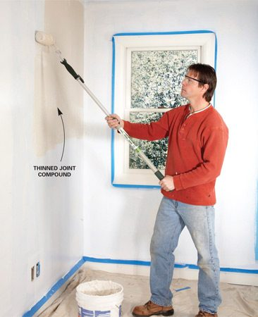<b>Photo 2: Roll on the mud</b></br> Spread a layer of slightly thinned all-purpose joint compound on the walls with a heavy-nap roller. Work in small sections so you can smooth out the joint compound before it starts to dry.