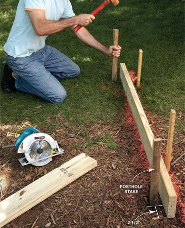 <b>Photo 3: Dig postholes</b></br> Mark the posthole using the joist as your guide. Set aside the joist and dig 2-ft.-deep postholes, add 6 in. of gravel, then rest the uncut posts in the holes.